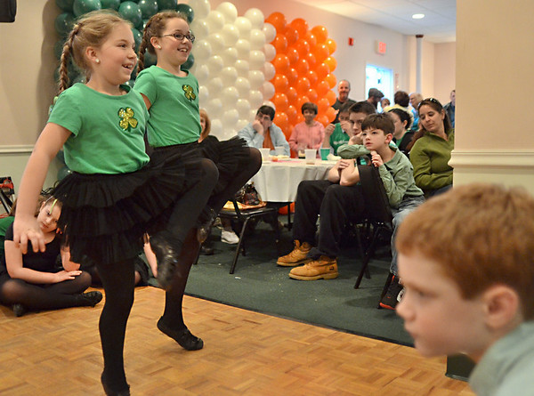 Salem: Tess Nally, 7, left, and her sister Shaela, 9, of Beverly Irish step dance at the Salem AOH on St. Patrick's Day.  photo by Mark Teiwes / Salem News