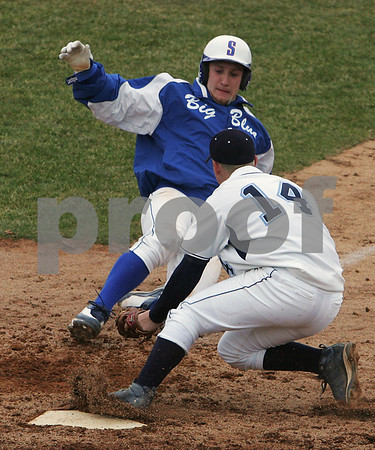 Danvers: Hunter Gordon from Swampscott gets tagged out at home plate by Nick Gikas from Danvers while trying to score during the sixth inning of the Big Blue's away game in Danvers on Wednesday. Photo by Matthew Viglianti/Staff Photographer Wednesday, April 8, 2009.