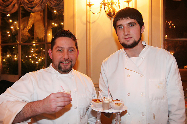 Salem: Christopher DeStefano, left, and Peter Bowman from Christopher's Table in Ipswich hold up a plate of cookies and drinks they made for the Cookie Creations fundraiser in Salem on Thursday night. Each participating chef used Girl Scout Cookies as a main ingredient in their desserts, in hopes of raising money for the Girl Scouts of Eastern Massachusetts. DeStefano made peanut butter and jelly bars, as well as a peanut butter milk shake. Photo by Matthew Viglianti/Staff Photographer Thursday, January 21, 2010.