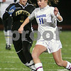 Lynn: Brittany Russo, a junior forward for the Danvers Falcons, right, cuts upfield while under pressure from Bishop Fenwick junior Sara Previte during the first half of the Division 2 North semifinal game in Lynn on Thursday. Russo scored three times for the Falcons, who won the game 6-0 to advance to the next round of the state tournament. Photo by Matthew Viglianti/Staff Photographer Thursday, November 12, 2009.