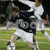 Woburn: St. John's Prep junior Zachary Hathaway shields the ball against Framingham senior Raul Urzua during the first half of the teams' Division 1 North final in Woburn on Sunday. Photo by Matthew Viglianti/Staff Photographer Sunday, November 16, 2008.