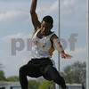 "Peabody: Pablo Sosa, a senior at Bishop Fenwick High School, competes in the long jump for Fenwick during the track team's home meet against St. Mary's of Lynn and Cathedral High Schools on Tuesday afternoon. Sosa's first jump measured 19'1"". Photo by Matthew Viglianti/Staff Photographer Tuesday, April 28, 2009."