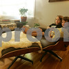 Marblehead: Brothers Luca, 5, left, and Nico, 2, Sherwood share a seat on their mother's Mid Century Modern chair in the living room of their home in Marblehead. Photo by Matt Viglianti/Salem News Monday, September 08, 2008