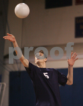 Danvers: St. John's Prep senior Patrick Heffernan keeps his eye on the ball while serving for the Eagles during the first game of their state tournament match against Cambridge in Danvers on Wednesday. Photo by Matthew Viglianti/Staff Photographer Wednesday, May 27, 2009.