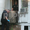 Beverly: Animal control officers carry a crate of cats out of 32 Roundy Street in Beverly on Tuesday afternoon. The house is being condemned. Photo by Matthew Viglianti/Staff Photographer Tuesday, June 9, 2009.