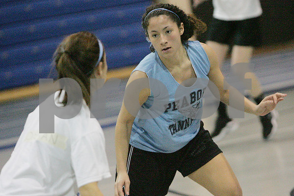 Peabody: Kenia McKeon defends the ball during try-outs for the Peabody basketball team on Wednesday. Photo by Matt Viglianti/Salem News Wednesday, December 03, 2008