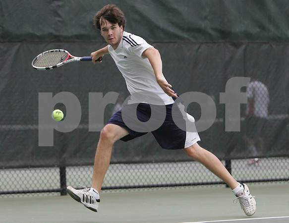 Worcester: Hamilton-Wenham senior Charlie Graves stretches to return a shot against Matt Vaughan from Mount Greylock during the first singles match of the state team championship match between Hamilton-Wenham and Mount Greylock at Clark College in Worcester on Thursday afternoon. Hamilton-Wenham won the match to capture the state team title. Photo by Matthew Viglianti/Staff Photographer Wednesday, June 10, 2009.