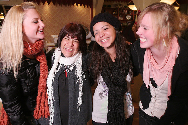 Saugus: From left to right, Anna Grundner from Austria, Joanne Dooley, a local childcare coordinator for Cultural Care Au Pair, Graziele Alves from Austria, and Nadine Drolshagen from Germany enjoy themselves at Prince PIzza in Saugus, where a group of about 40 North Shore au pairs from all over the world gathered for a holiday party on Wednesday night. Photo by Matthew Viglianti/Staff Photographer Wednesday, December 16, 2009.