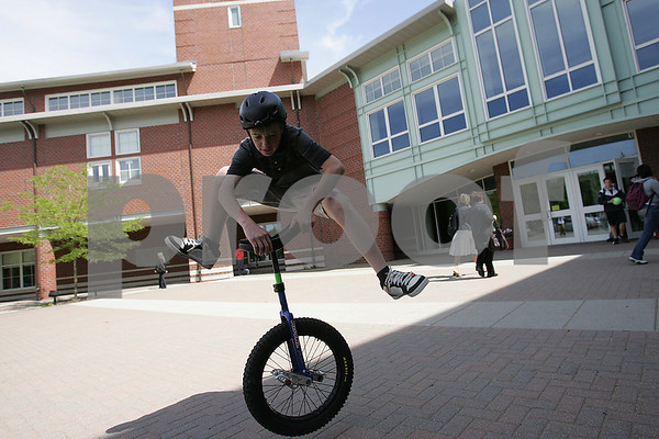 Marblehead: Jeremy Rubin, a freshman at Marblehead High School, performs a trick on his unicycle outside the high school on Tuesday afternoon. Rubin has been riding for three years, and commutes the one mile to and from school on his unicycle. Photo by Matthew Viglianti/Staff Photographer Tuesday, May 26, 2009.