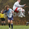 Topsfield: Masconomet senior captain Brian Connery leaps to take the ball out of the air ahead of Swampscott senior captain Walter Morrell during the second half of Masconomet's 2-0 win over the Big Blue in Division 2 North quarterfinal action in Topsfield on Tuesday. Photo by Matt Viglianti/Salem News Tuesday, November 11, 2008