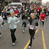 Salem: Over 1,000 runners race down Derby Street in Salem during the 5th annual Wild Turkey 5 Mile Run on Thanksgiving morning. Photo by Matthew Viglianti/Staff Photographer Thursday, November 27, 2008.