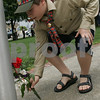 Beverly: Jake Viel from Beverly, 10, places flowers at the base of a flagpole in Veterans Memorial Park in Beverly during a Memorial Day celebration on Sunday. Viel walked in the parade with other members of Beverly Boy Scouts Pack 4. Photo by Matthew Viglianti/Staff Photographer Sunday, May 24, 2009.