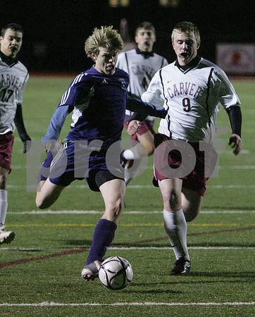 Weymouth: Hamilton-Wenham junior Drew Erdman winds up for a shot during the second half of the Generals' state semifinal tournament game against Carver in Weymouth on Tuesday. The Generals won the game 1-0 to advance to the state final this Saturday. Photo by Matthew Viglianti/Staff Photographer Tuesday, November 18, 2008.