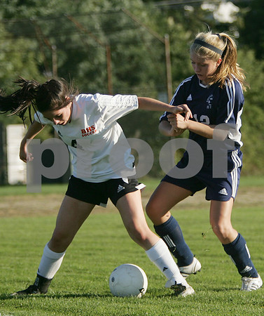 Beverly junior Bridget Leahy, left, shields the ball from Swampscott junior Robin Herlihy.