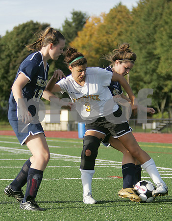 Peabody: Bishop Fenwick senior captain Bianca Gallo works against Archbishop Williams juniors Colleen Downing, left, and Kate Moriarty during the first half of Fenwick's home game on Wednesday. Fenwick won the game 5-2. Photo by Matt Viglianti/Salem News Wednesday, October 08, 2008