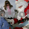 Beverly: Lane Normand, 5, from Beverly hands Santa a letter at the city pier in Beverly, where Santa visited to greet children on Sunday afternoon. Normand listed a Miley Cyrus doll as one of the things she wants most for Christmas this year. Photo by Matt Viglianti/Salem News Sunday, December 14, 2008