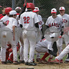 Topsfield: The Masconomet baseball team greets Andy Roach at home plate after Roach hit a two-run home run during Masco's home game against Andover on Monday. Photo by Matthew Viglianti/Staff Photographer Monday, April 20, 2009.