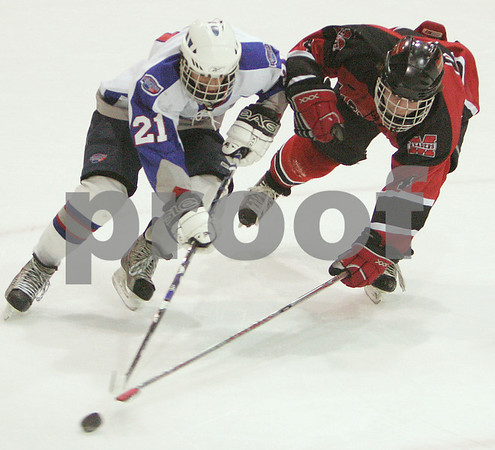 Salem: Marblehead junior Anders Gunderson, right, reaches to poke check the puck away from Swampscott junior Anthony Dipietro during the first period of their teams' state tournament game in Salem on Sunday. Photo by Matthew Viglianti/Staff Photographer Sunday, March 1, 2009.