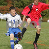 Peabody: Jack Palmachuk from the U-12 Peabody Bombers, left, and Justin D'Orlando from the U-12 Middleton Snipers fight for the ball during the first half of their teams' championship game during the 18th annual Peabody Youth Soccer Columbus Day Tournament on Monday. Photo by Matt Viglianti/Salem News Monday, October 13, 2008