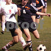 Salem: Beverly junior Bridget Leahy, right, challenges Salem sophomore Lauren Schaejbe during the first half of the Witches home game against Beverly on Monday night. Photo by Matt Viglianti/Salem News Monday, October 27, 2008
