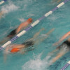 Beverly: The Beverly High School swim team blurs through their warm-ups before the start of their meet against Marblehead at the Sterling Center YMCA on Thursday. Photo by Matthew Viglianti/Staff Photographer Thursday, January 14, 2010.