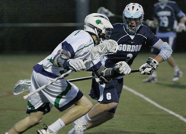 Beverly: Gordon College junior Stuart Knechtle, right, focuses on defending an offense push by Endicott College junior Jack Curtis during their teams' game at Endicott on Wednesday. Gordon won the game 7-5. Photo by Matthe Viglianti/Staff Photographer Wednesday, March 24, 2010.