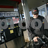 Peabody: Dan Russo of Peabody pumps gas for a customer at Best Gas Station on Route 1 North in Peabody on Tuesday afternoon. Russo says business was busy on Monday after the station dropped its price to $3.06 a gallon for regular unleaded gasoline earlier in the day. Photo by Matt Viglianti/Salem News Tuesday, October 07, 2008