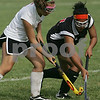 Marblehead: Louiginna Rijo from Salem, right, turns away from Marblehead's Hannah Wolfe during their matchup in Marblehead on Tuesday. The game opened the 2008 season for both teams. Photo by Matt Viglianti/Salem News Tuesday, September 02, 2008