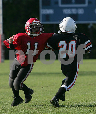 Salem: Nathaniel Minaya from Salem (11) reaches to tackle Andrew Avila from Beverly during their youth football game in Salem on Sunday. Photo by Matthew Viglianti/Staff Photographer Sunday, October 12, 2008.
