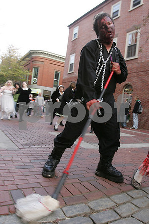 Salem: Steven McCaw from Swampscott sweeps the Essex Street Pedestrian Mall in Salem during the Zombie Walk on Sunday. Photo by Matt Viglianti/Salem News Sunday, October 05, 2008