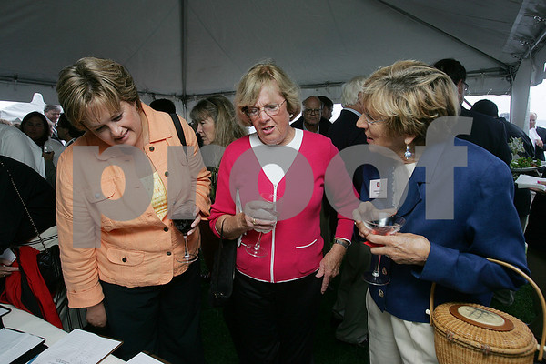 Salem: From left, Kersten Lanes from Gloucester, Jean Howe from Marblehead, and Chris Patton from Danvers, discuss an item up for auction during Gables Lobsterfest at the House of the Seven Gables in Salem on Sunday. Photo by Matt Viglianti/Salem News Sunday, September 14, 2008