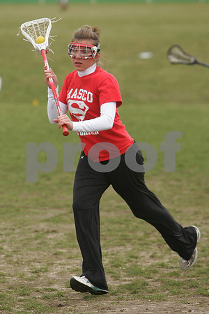 Topsfield: Masconomet senior Kate Evans practices with the lacrosse team on Tuesday afternoon. Evans survived a car accident last May. Photo by Matthew Viglianti/Staff Photographer Tuesday, April 7, 2009.