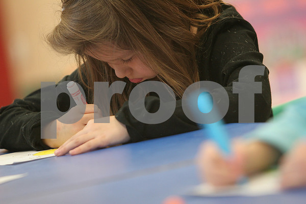 Danvers: Hannah Golden concentrates on her coloring during the Danvers YMCA after school program on Tuesday afternoon. Photo by Matt Viglianti/Salem News Tuesday, December 02, 2008