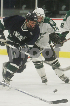 Hamilton: Matt Machiros, a senior at Pingree, left, draws a penalty on Peter Quigley from Hebron Academy during the second period of the Highlanders' home game against Hebron Academy in Hamilton on Wednesday. Photo by Matt Viglianti/Salem News Wednesday, January 21, 2009