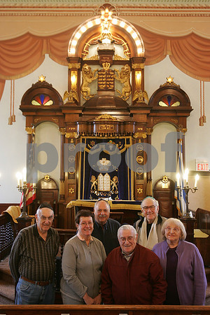 Peabody: From left to right, Milton Kellerman, Barbara Sigel, Dan Leavitt, Harvey Chandler, Irving Sacks, and Paula Chandler stand in front of the bimah at the Congregation Sons of Israel in Peabody on Monday afternoon. The temple is celebrating its 100th anniversary this year. Photo by Matthew Viglianti/Staff Photographer Monday, April 6, 2009.