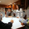 Boxford: Chris Kreider, second left, speaks with a Salem News reporter at his family's home in Boxford on Thursday night. Kreider, who played hockey for two years at Masconomet, starred for Phillips Academy in Andover, and is expected to be chosen in the first round of next week's National Hockey League Draft in Montreal. Photo by Matthew Viglianti/Staff Photographer Thursday, June 18, 2009.