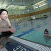 Peabody: Tim Tsui, 13, from Lynnfield, hangs out by the side of the pool as John Gagnon, 9, of Peabody, swims laps while participating in Piranha-thon 2009, a fundraising event in which the team members swim for as many laps as they can without leaving the water, at the Peabody-Lynnfield YMCA on Tuesday. The Piranhas are a swim team out of the YMCA. Photo by Matthew Viglianti/Staff Photographer Tuesday, February 10, 2009.