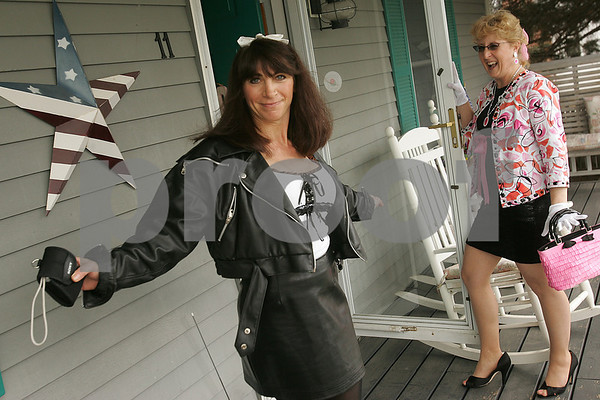 "Danvers: Marie Oliver of Danvers, right, laughs as her childhood friend, Darla Mazola of Danvers, pauses mid-step to pose during a Barbie fashion show at Oliver's 50th birthday party on Sunday. Oliver invited her friends to over to dress as their favorite Barbie and donate money to the Susan G. Komen Breast Cancer Foundation in lieu of buying her birthday gifts. Mazola dressed as ""Motorcycle Barbie"" for the occasion. Photo by Matthew Viglianti/Staff Photographer Sunday, March, 22, 2009."