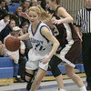 Peabody: Peabody junior Hannah Simard, left, dribbles around Gloucester's Heather Cain during their teams' game at the Peabody High School field house on Thursday night. Photo by Matthew Viglianti/Staff Photographer Thursday, January 28, 2010.