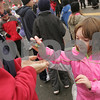 Beverly: Sarah Carroll, 7, from Peabody drops off one of the many handfuls of candy thrown from floats that she collected with her sisters, Meagan, 5, and Erin, 7, to her father, Dave, during the annual holiday parade in Beverly on Sunday. Photo by Matt Viglianti/Salem News Sunday, November 30, 2008