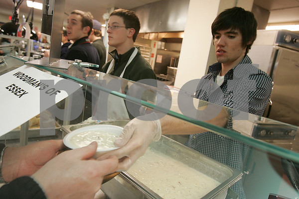 Danvers: Sam Therrien, a St. John's Prep junior from Reading, serves a bowl of clam chowder from Woodman's of Essex during 10th annual Empty Bowls Dinner Party at the Prep on Thursday. Over 400 bowls made by Prep students were on sale as part of the fundraiser, which raises money for Haven from Hunger in Peabody. Photo by Matt Viglianti/Salem News Thursday, January 15, 2009