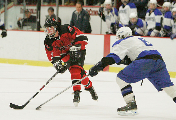 Cambridge: Marblehead junior forward Hunter Graves looks for space against Scituate junior Harold Gerbis during the Division 3 state semifinal at the Bright Center at Harvard University on Wednesday night. Marblehead fell to Scituate 5-2. Photo by Matthew Viglianti/Staff Photographer Wednesday, March 10, 2010.