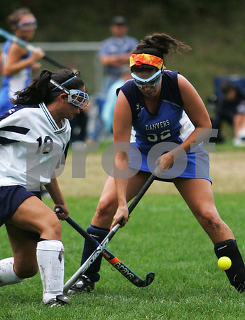 Peabody: Christina Simoes from Peabody, left, challenges Danvers forward Taylor Cross during the second half of their game at Peabody on Monday. Photo by Matt Viglianti/Salem News Monday, September 29, 2008