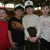 Beverly: From left to right, seven-year-olds, Ian Guilmet, Jack tenHope, Joshua Morin, and Riley Shea, participated in the 28th annual Beverly Little League indoor winter clinic at Beverly High School on Sunday. Photo by Matthew Viglianti/Staff Photographer Sunday, January 24, 2010.