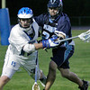 Danvers: Nick Serino from Danvers, left, fights for a loose ball with Buddy Kozinski from Peabody during the second half of their team's game in Danvers on Thursday. Photo by Matthew Viglianti/Staff Photographer Thursday, May 13, 2010.