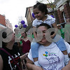 Salem: Giselle Martinez, 3, rides on her mother Ana's shoulders as Salem State College student Emily Bardales walks with them through Salem during the annual Walk for HAWC (Help for Abused Women and their Children) fundraiser on Sunday afternoon. Hundreds of walkers turned out to raise money for the organization. Photo by Matthew Viglianti/Staff Photographer Sunday, April 26, 2009.