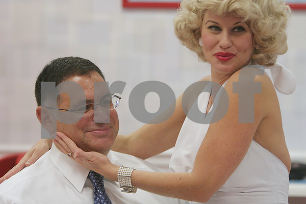 Salem: Local attorney John Morris smiles at his friends as Marilyn Monroe impersonator, Julie Bannerton from Brookline, serenades him at Rita's Slush in Salem on Wednesday. Morris is turning 50, and a group of lawyers chipped in for the surprise to celebrate his birthday. Photo by Matt Viglianti/Salem News Wednesday, October 01, 2008