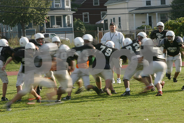 Beverly: Beverly High School varsity football coach Dan Bauer watches his team during a drill at practice on Wednesday afternoon. Photo by Matt Viglianti/Salem News Wednesday, September 17, 2008