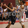 Salem: Erica Mendez from Salem, right, guards Peabody's Kerrie O'Shea during the fourth quarter of the Witches' game against Peabody in Salem on Tuesday. Salem won the game 40-28. Photo by Matthew Viglianti/Staff Photographer Tuesday, February 3, 2009.