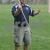 Hamilton: Jim LeSelva, head coach of the Hamilton-Wenham boys varsity lacrosse team, instructs his players during practice on Monday afternoon. LeSelva recently recorded his 100th win, and the Generals have won six of their last seven games after starting the season 0-5. Photo by Matthew Viglianti/Staff Photographer Monday, May 4, 2009.